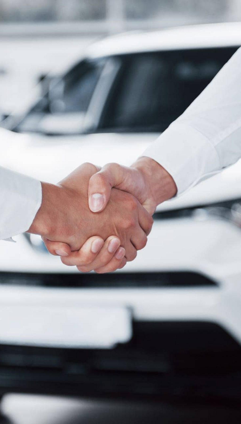 close-up-sales-manager-black-suit-selling-car-customer